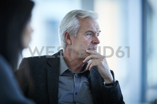 Serious senior businessman looking away - CAIF12666