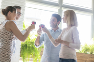 Friends toasting wine glasses - CAIF12738