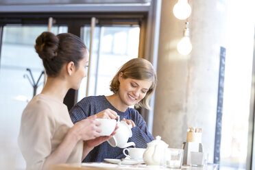 Women drinking tea in cafe - CAIF12795