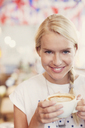Close up portrait blonde woman drinking cappuccino - CAIF12837