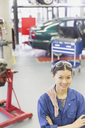 Portrait confident mechanic with arms crossed in auto repair shop - CAIF12858