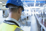 Worker with clipboard in factory - CAIF12966
