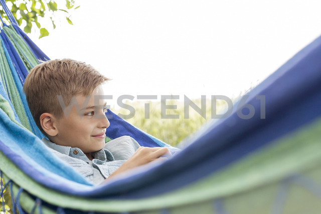 Boy relaxing in hammock - CAIF13065