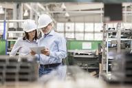 Engineers using digital tablet in steel factory - CAIF13200