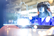 Welder using welding torch in factory - CAIF13206