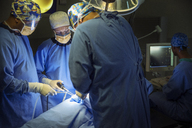 Surgeons performing surgery in operating room - CAIF13320