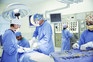 Surgeons performing surgery in operating room - CAIF13347