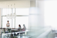 Businesswomen talking in conference room - CAIF13377