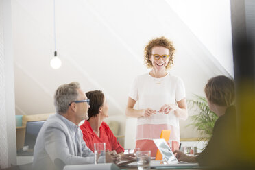 Four people at meeting in office - CAIF13764