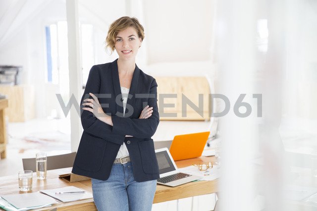 Portrait of young woman at office - CAIF13821