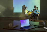 Business people preparing audio visual presentation in conference room - CAIF13923