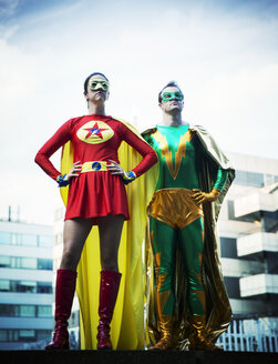 Superheroes standing on city rooftop - CAIF13932