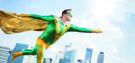 Superhero flying on city rooftop - CAIF13962