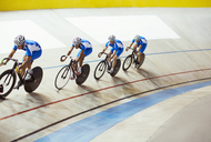 Track cycling team riding in velodrome - CAIF14118