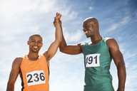 Athletes celebrating together on track - CAIF14130