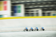 Track cycling team racing in velodrome - CAIF14136