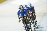 Track cycling team riding in velodrome - CAIF14139