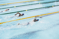 Swimmers racing in pool - CAIF14142