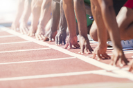 Runners poised at starting blocks on track - CAIF14148
