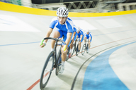 Track cyclist racing in velodrome - CAIF14169