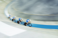 Track cycling team racing in velodrome - CAIF14172