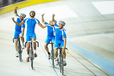 Track cycling team celebrating on track - CAIF14178