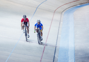 Track cyclists riding in velodrome - CAIF14181