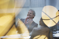 Smiling businessman clapping in meeting - CAIF14187