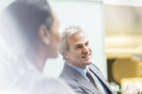 Smiling businessman in meeting - CAIF14196