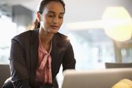 Businesswoman using laptop - CAIF14220