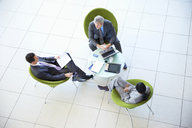 High angle view of business people meeting in lobby - CAIF14229