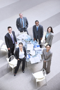 High angle portrait of smiling business people at table - CAIF14244