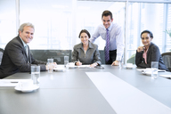 Portrait of smiling business people meeting in conference room - CAIF14247