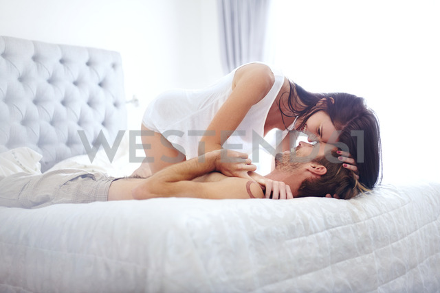 Sexy couple laying on bed - CAIF14397