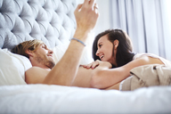 Casual couple laying on bed - CAIF14403