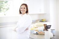 Portrait confident chef in kitchen - CAIF14424