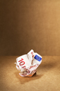 Crumpled 10 Euro note on counter - CAIF14472