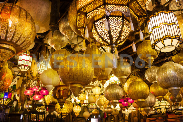 Low angle view of various illuminated lamps in market - CAIF14547