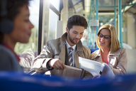 Business people talking on train - CAIF14568