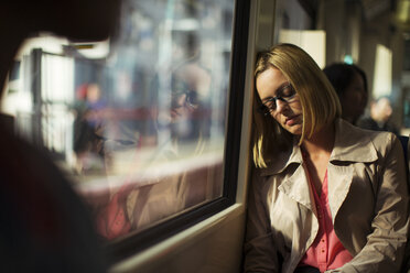Businesswoman napping on train - CAIF14571