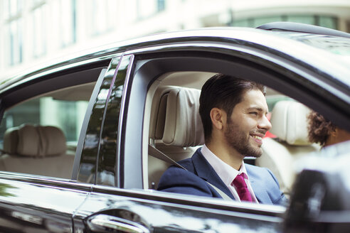 Businessman smiling in car - CAIF14595