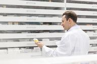 Pharmacist filling prescription in pharmacy - CAIF14706