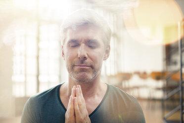 Close up of older man meditating - CAIF14853