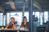 Businesswomen talking in office meeting - CAIF14883