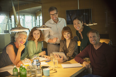 Business people smiling in office meeting - CAIF14901