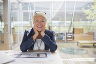 Businesswoman smiling in office - CAIF14916