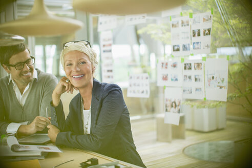 Business people smiling in office - CAIF14919