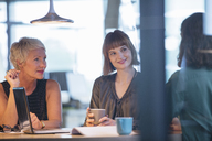 Businesswomen talking in office meeting - CAIF14928