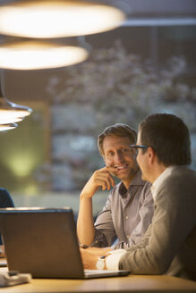 Businessmen talking in office meeting - CAIF14937