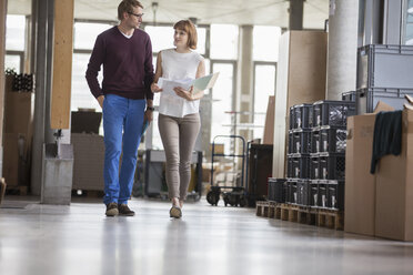 Business people walking in office - CAIF14943